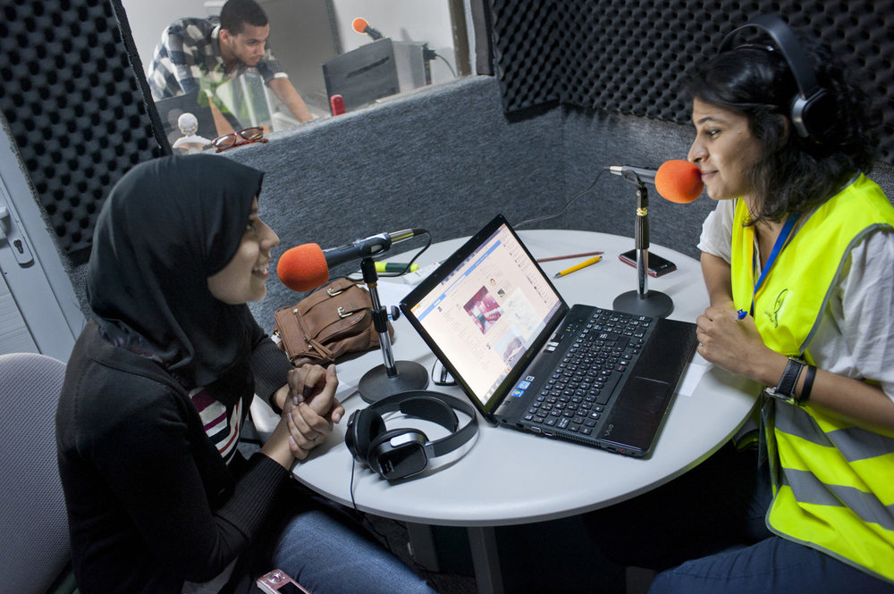 Radio host Ayo interviews Issraa Murabit after she voted on July 7th, 2012 in one of Tripoli's english language stations Tripoli FM. After 42 years of Muammar Gaddafi's reign, Libyans are participating in the first democratic election since 1969.