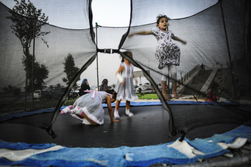 Girls jump on a trampoline in an amusement park in Tripoli, Libya. On July 6th 2012