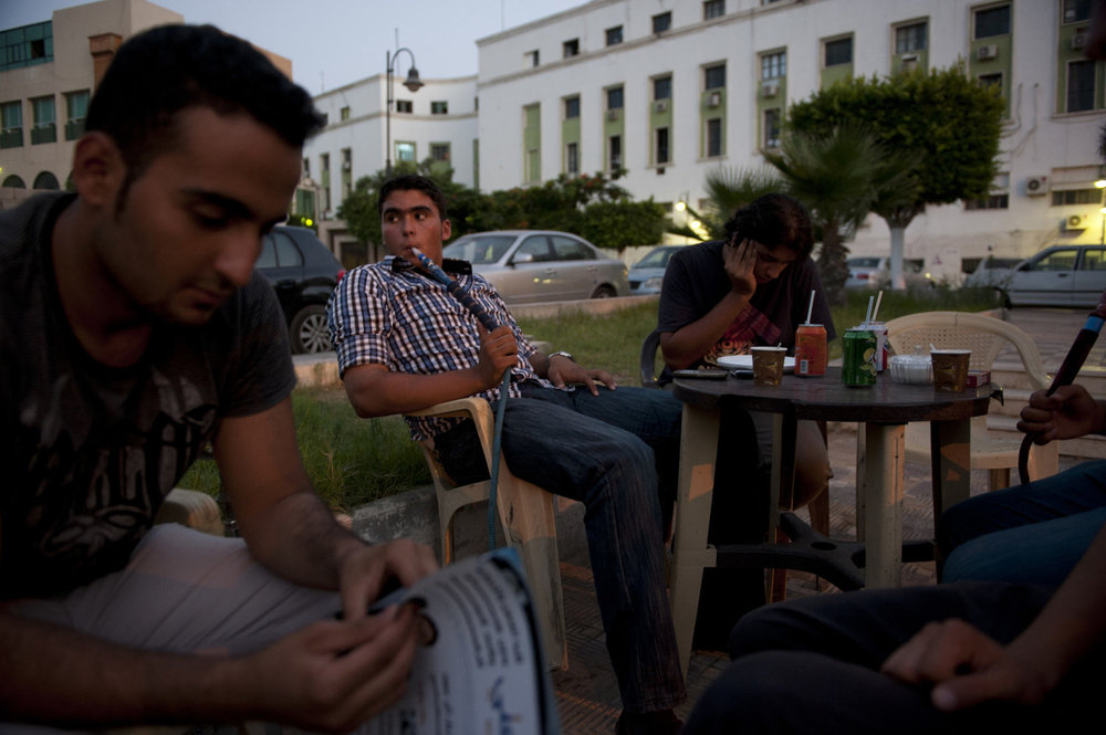 Medical students talk in a downtown cafe on July 10th, 2012 in Tripoli, Libya.