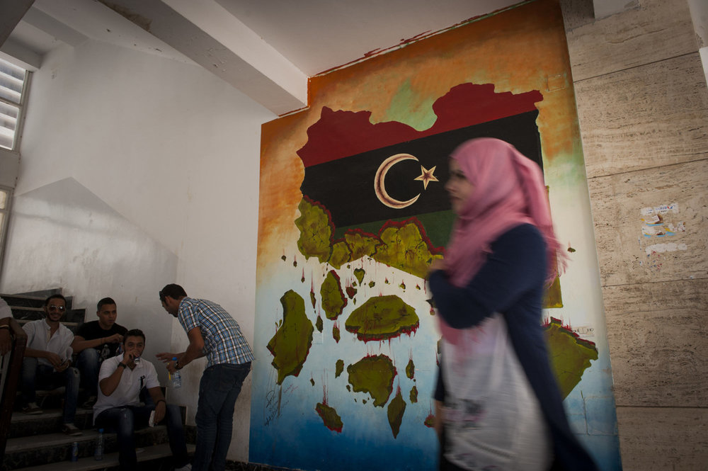 Students at Tripoli University, in front of a mural painted by Bilal and Nazih on July 12th 2012.