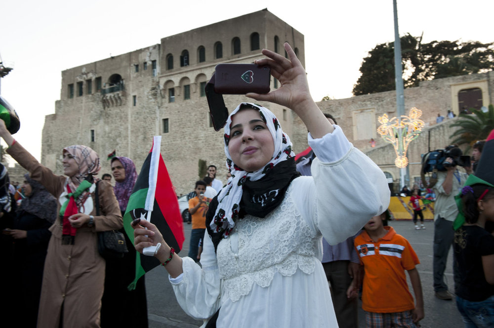 Libyans celebrate after voting in Martyr's Square after voting. Formally called Green Square, where Col. Gaddafi would make yearly speeches.