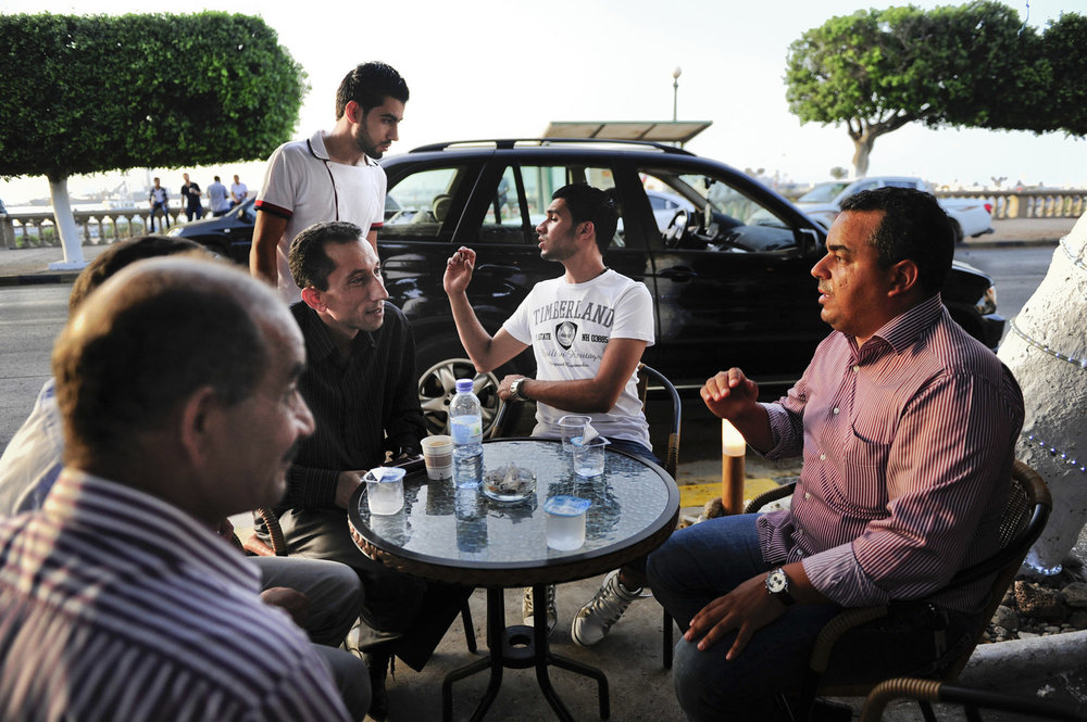 A group of men debate politics outside of a coffee house on the eve of the country's first election since the end of the Gaddafi rule, Calls for boycott and election violence threatens the momentous day as campaigning drew to a close the day before the July 7th election.