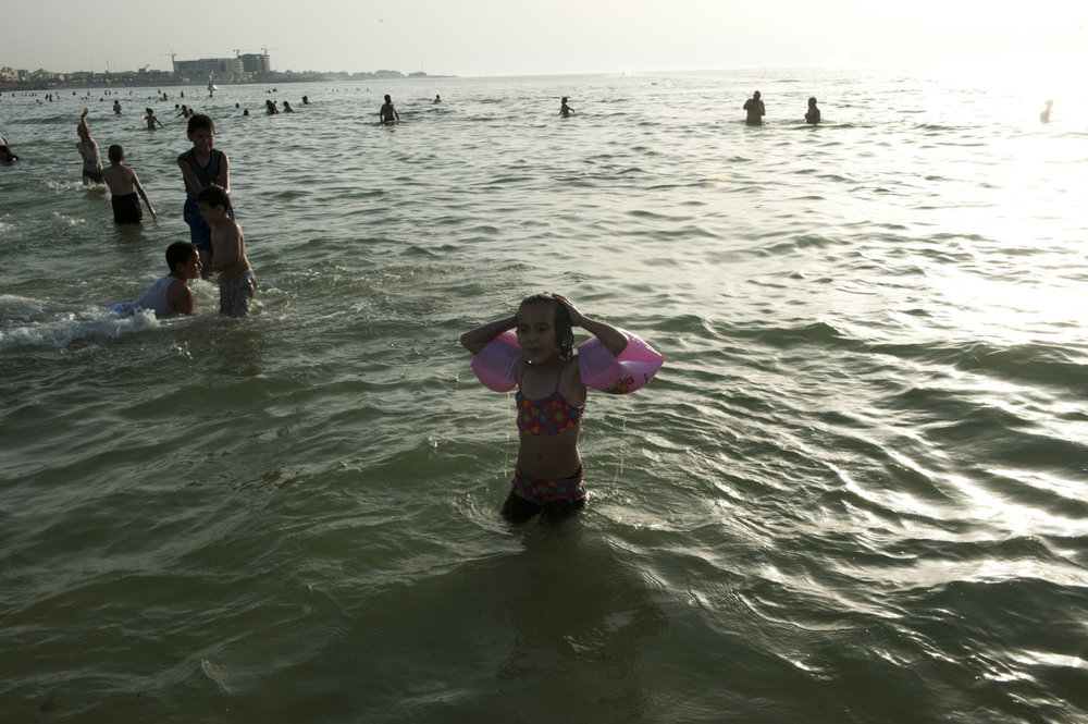 A girl surfaces after swimming in the ocean in downtown Tripoli on July 1st, 2012.