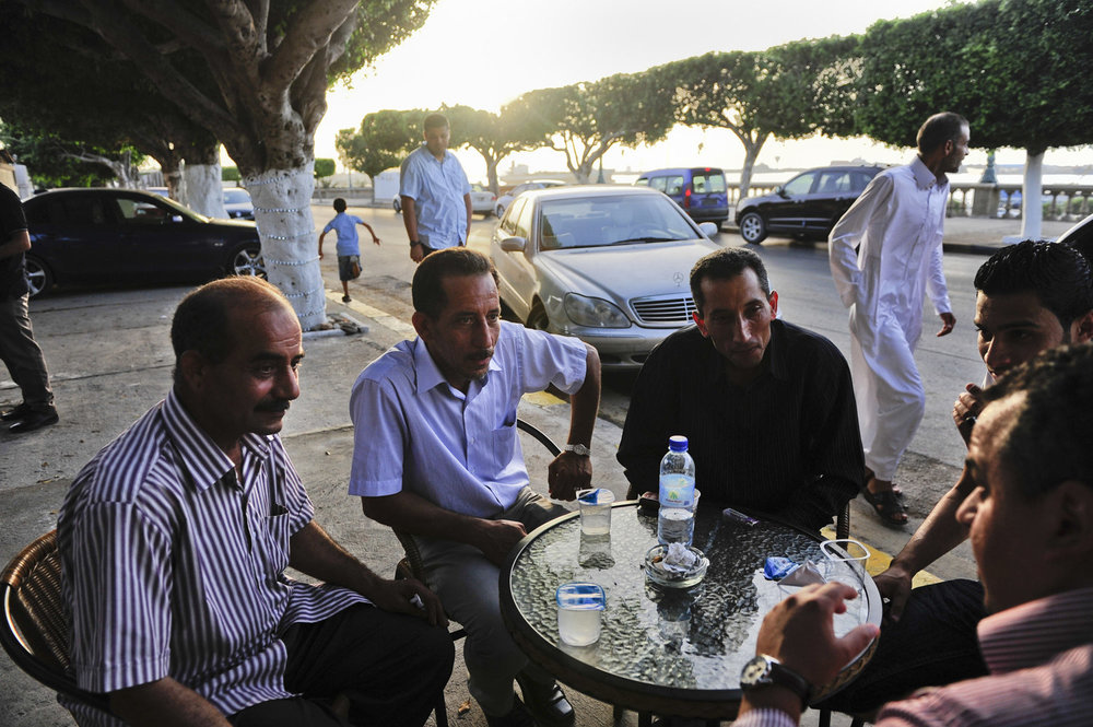 A group of men debate politics outside of a coffee house on the eve of the country's first election since the end of the Gaddafi rule, July 6th, 2012. After 42 years of Muammar Gaddafi's reign, Libyans are participating in the first democratic election since 1969.