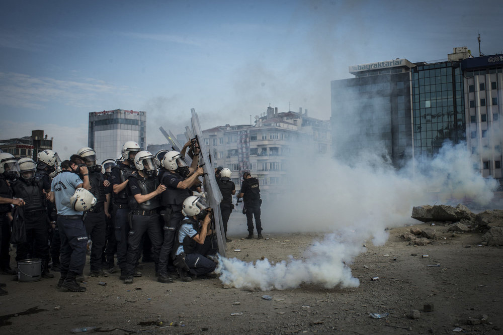 As the police take back Taksim square from the protesters, tear gas canisters originally thrown at the protesters are returned to the police on June 11, 2013 in Istanbul, Turkey.