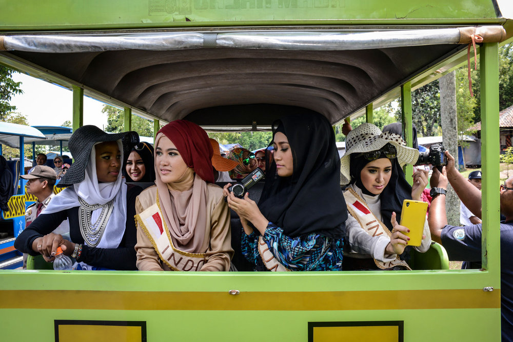 The Miss Muslimah finalists visit Borobudur,  a 9th-century Mahayana Buddhist Temple outside of Yogakarta, Indonesia. Miss Muslimah 2014 an award competition in Indonesia, which intends to be the opposite of a beauty pageant.
