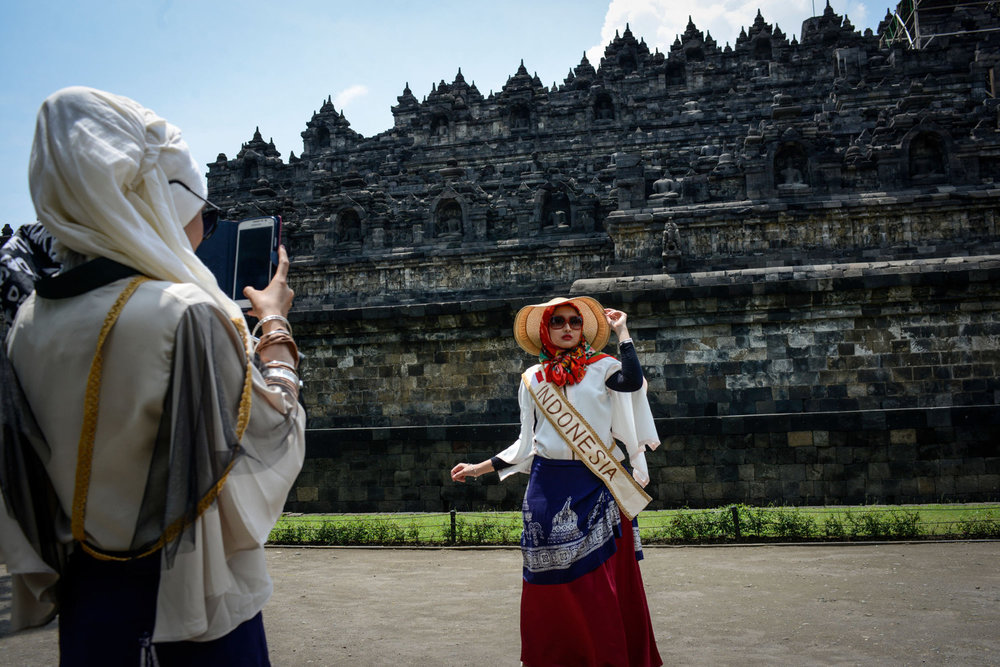 The Miss Muslimah Finalists take photos of themselves in front of Borobudur,  a 9th-century Mahayana Buddhist Temple outside of Yogakarta, Indonesia.