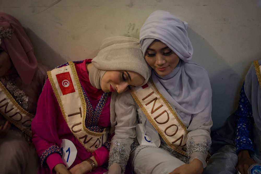 At The Grand Finale of the Miss Muslimah World Competition, backstage the girls are anxious and exhausted on November 21st, 2014 in Yogakarta, Indonesia. Pictured Muss Tunisia, Fatma Ben Guefrache, and Primadhita Rahma, one of the Indonesian finalists.
