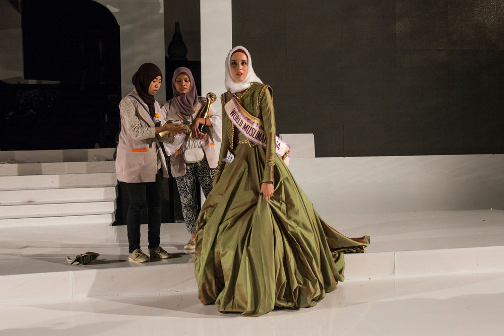 After the event is over, Miss Muslimah 2014- Fatma Ben Guefrache of Tunisia looks around the empty stage. The Grand Finale of the Miss Muslimah World Competition on November 21st, 2014 in Yogakarta, Indonesia.