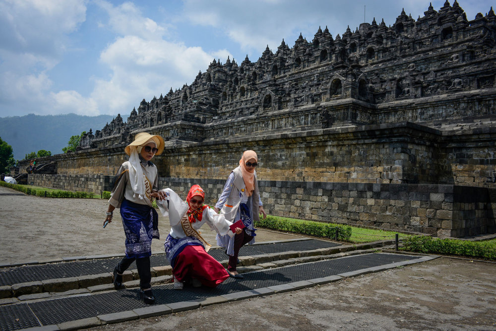 Two Indonesian finalists walk past Borobudur,  a 9th-century Mahayana Buddhist Temple outside of Yogakarta, Indonesia.