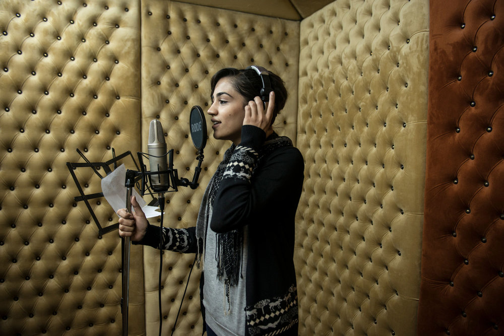 Hadeel Fawzy Abushar 25 records a song in a studio in Gaza City. Few female singers remain as families and local government look down on the practice. Hadeel started when she was 12, as all of her sisters are singers.
