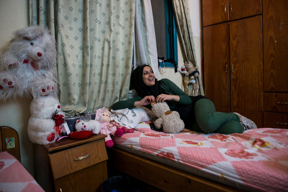 Doaa in a friends bedroom. Girls that are un-married have few places to be themselves. Bedrooms and private cars are sanctuaries where girls can sing and dance without being judged by the public, or their own families.