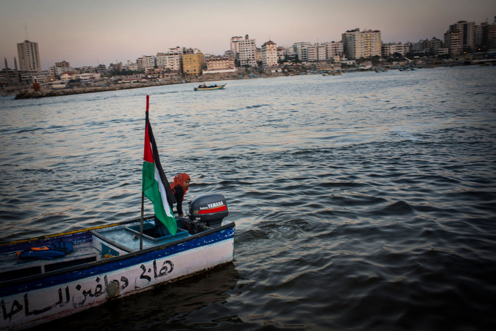 Madleen Koolab takes Gazan's out for rides on Thursday nights, a popular night for families. Madleen owns the boat and uses it to fish during the week.