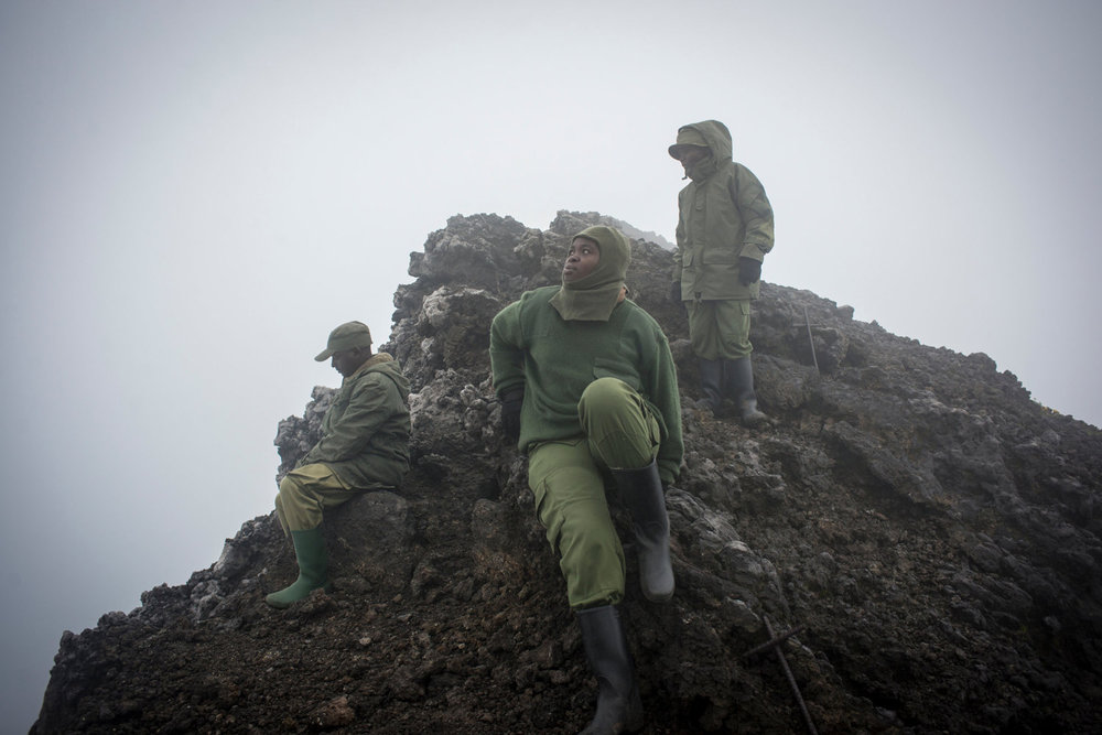 Francine and Solange sit on the crest of the volcano, which is fogged over. When clear, the lava lake is visible.For the first time, women have taken up the most dangerous job in wildlife, becoming para-military rangers at the Virunga National Park in DR Congo.