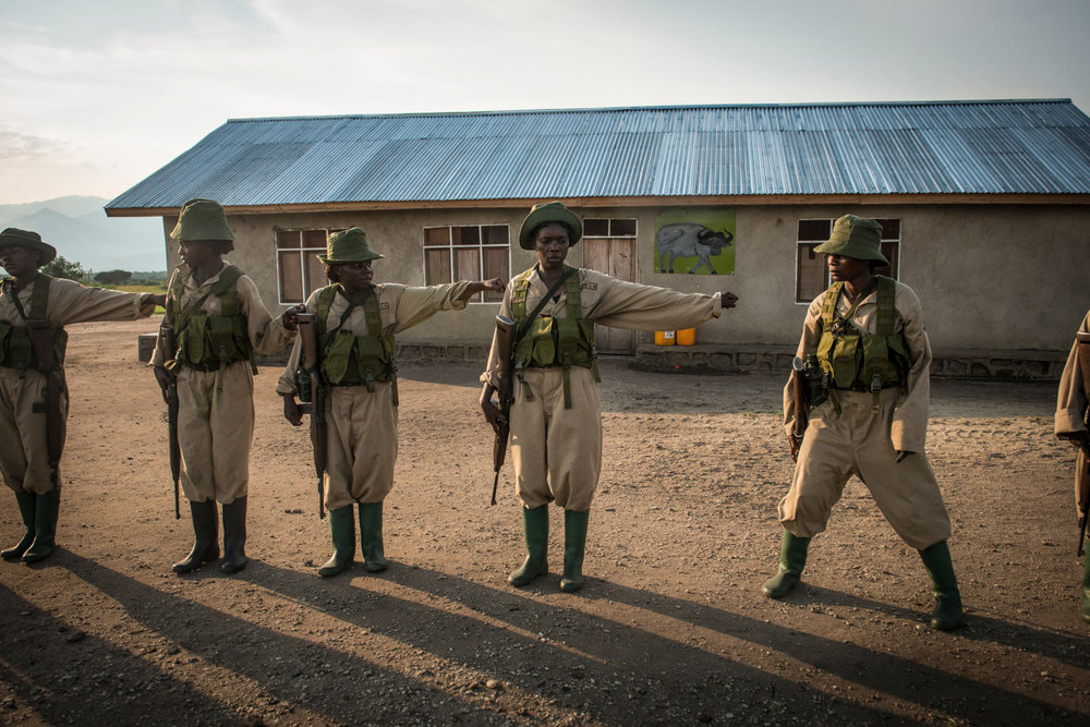 Rangers-in-Training returning to camp after a 4 hour patrol through the savannah. Virunga's park guards responsibilities eclipse those of a typical park guard as the area is known to have incidents with local rebel groups.