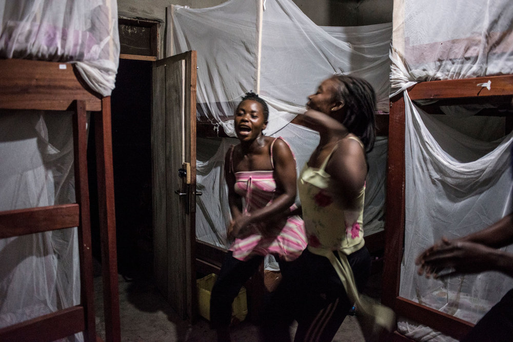In the evening, Rangers-in-Training dance and sing before going to bed in the all female dorm. For the first time, women have taken up the most dangerous job in wildlife, becoming para-military rangers at the Virunga National Park in DR Congo.