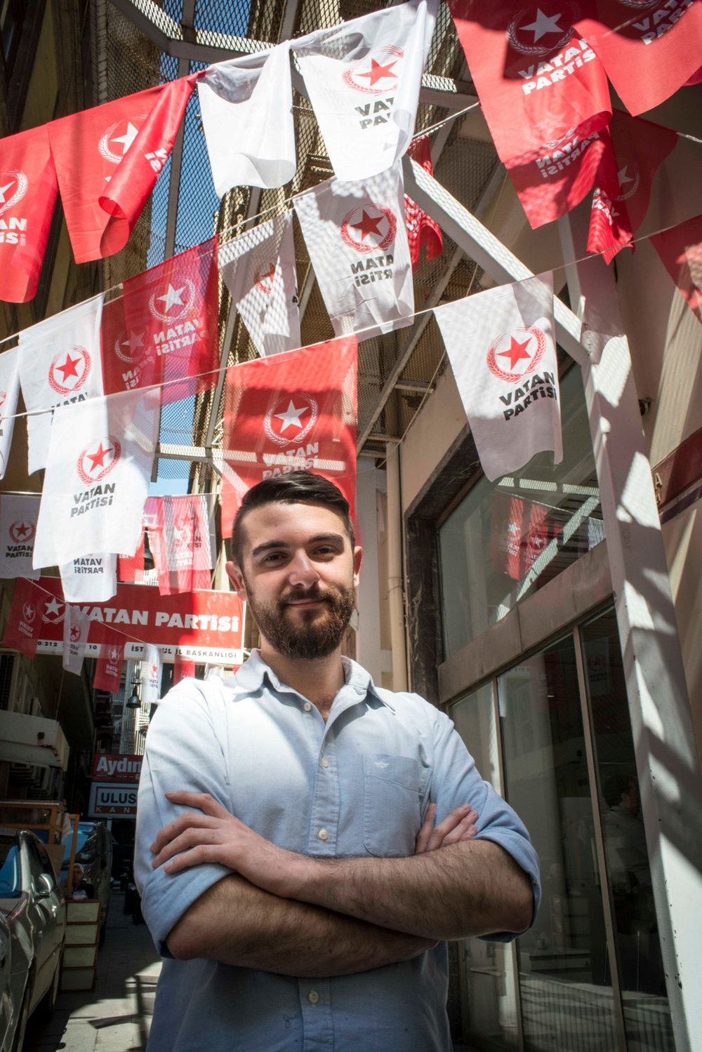 Engin Onder, Young Global Leader from Turkey. Photographed in Istanbul in front of the political flags for one of the parties running in the general election on May 5th 2015 for TIME Magazine.