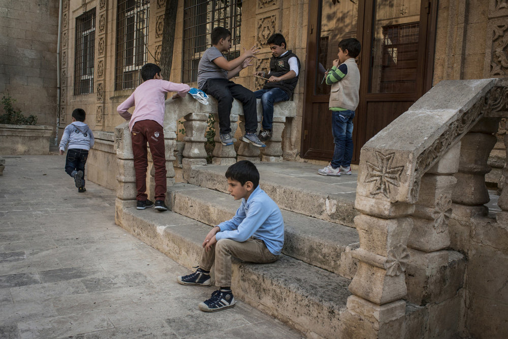 Assyrian boys play in the in the courtyard of Mor Barsaumo before an Aramaic lesson on October 30th, 2014.