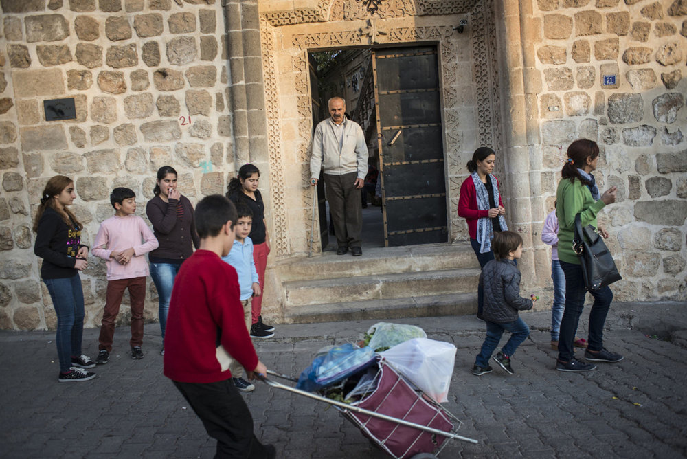 Members of the Asyrian community leave Mor Baraumo church after an afternoon service on October 30th, 2014.