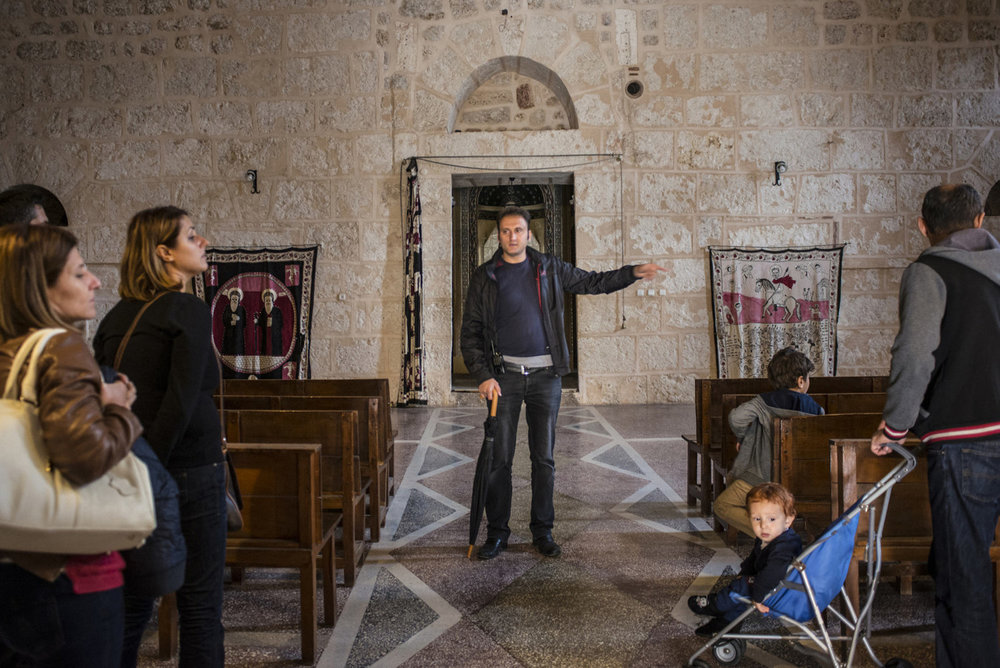 A guide gives a tour to a Turkish family visiting Mor Gabriel monastary on October 31st, 2014 20km outside of Midyat, Turkey.