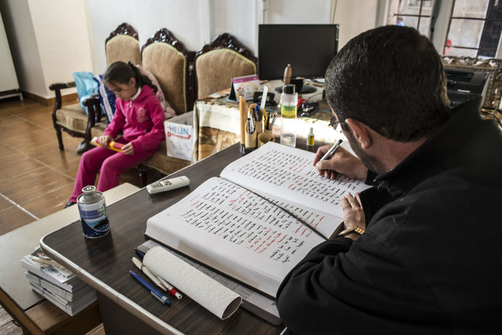 Decon Ayhan Gürkan reads from an Assyriac book before a church service at Mor Barsaumo church on October 31st, 2014.