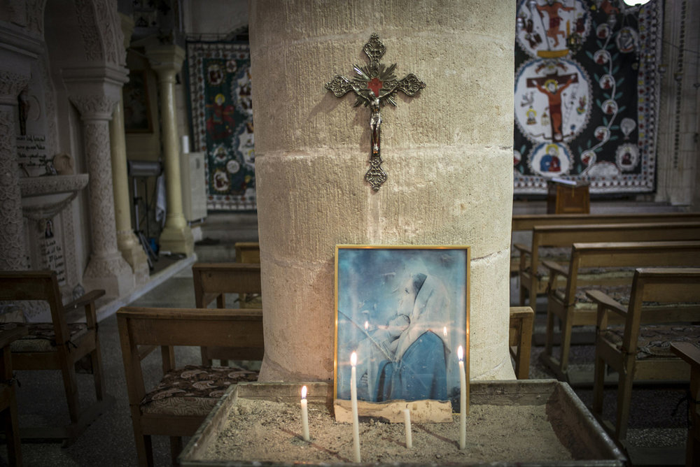 Candles lit before a church service at Mor Barsaumo church on October 31st, 2014.