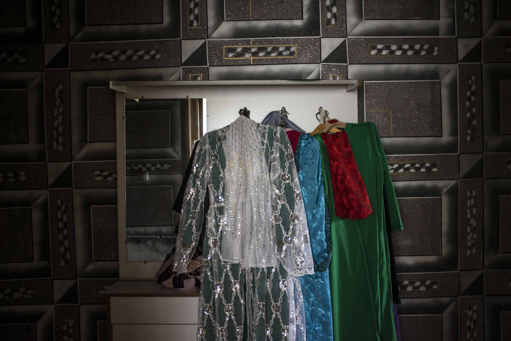 Traditional costumes hang in the home of one of the female Sufi leaders. The group has performed abroad, in countries diverse as Poland and Morocco.