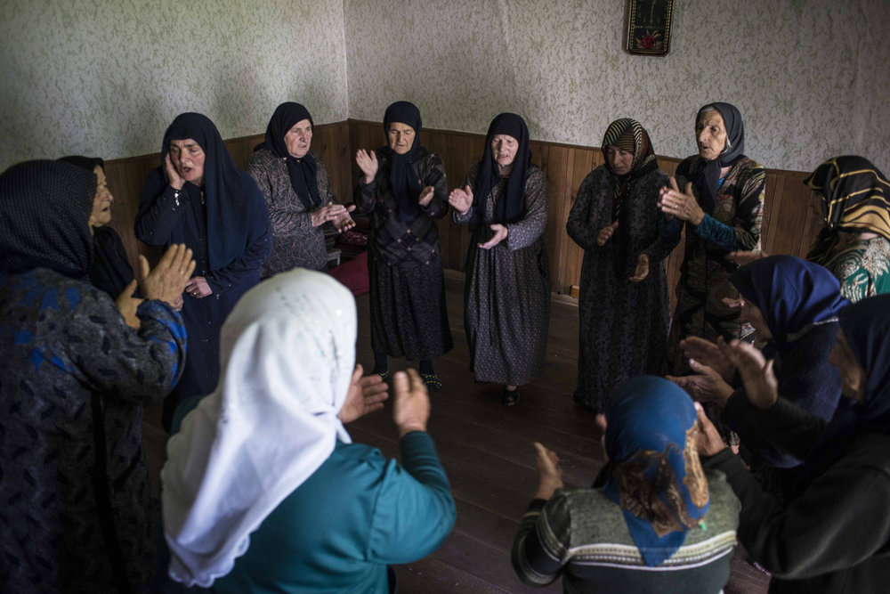 A circle of women Sufi sing and dance as part of �zikr,� a communal recital of the names of God. The women are part of a regular meeting that occurs in Duisi, the largest village in the Pankisi Valley.