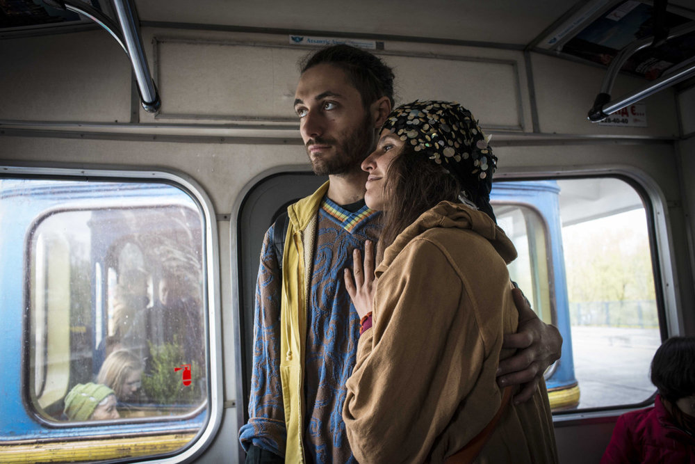 Actor/Musician Oleg Kozachenkono, 24 with his girlfriend on the metro in Kiev, Ukraine.