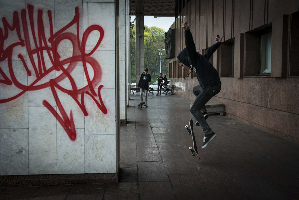 Boys skate outside of a government building. This place eas previously off limits to skaters before the revolution.