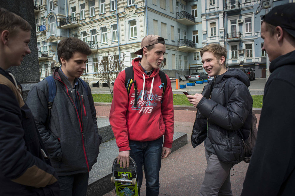 Members of the band Bonehouse between classes at the university in a park downtown in Kiev Ukraine.