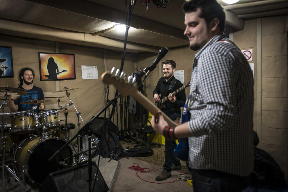Yevhen Revko, 22 Bassist in Urban FM (center) practices with his band.