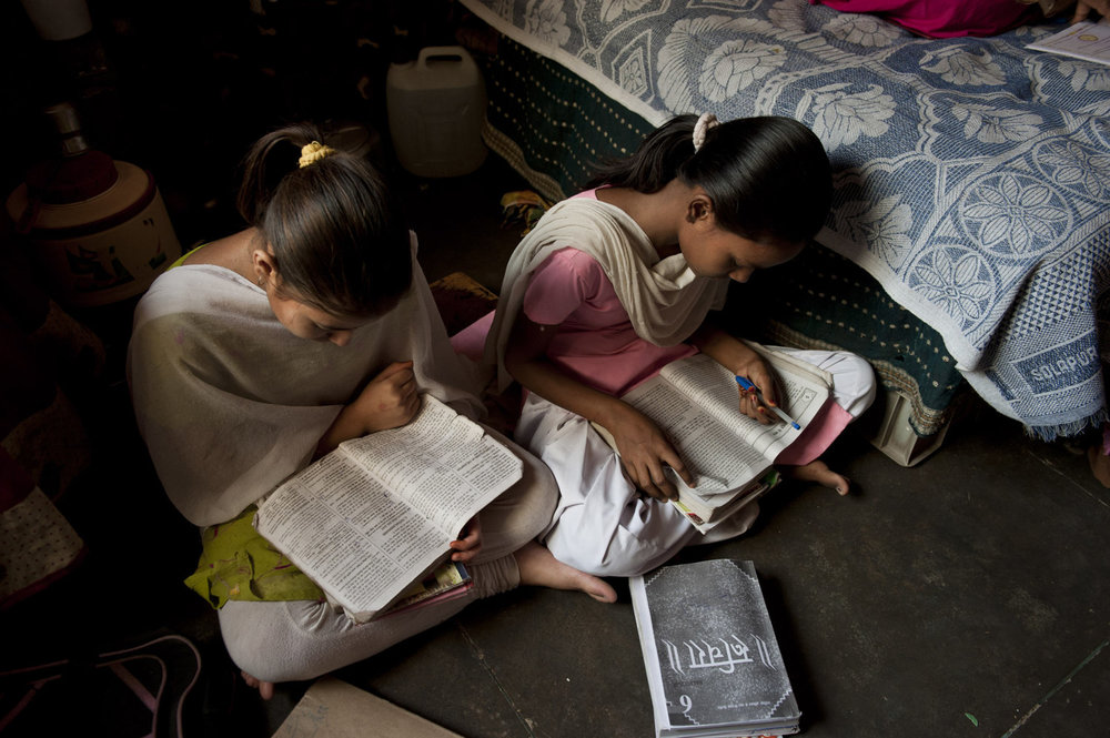 Girls practice reading at the Sadnha Institute Center in Mullahera- a make shift after school program run for the children of migrant workers there are about 100 kids taught in five shifts.