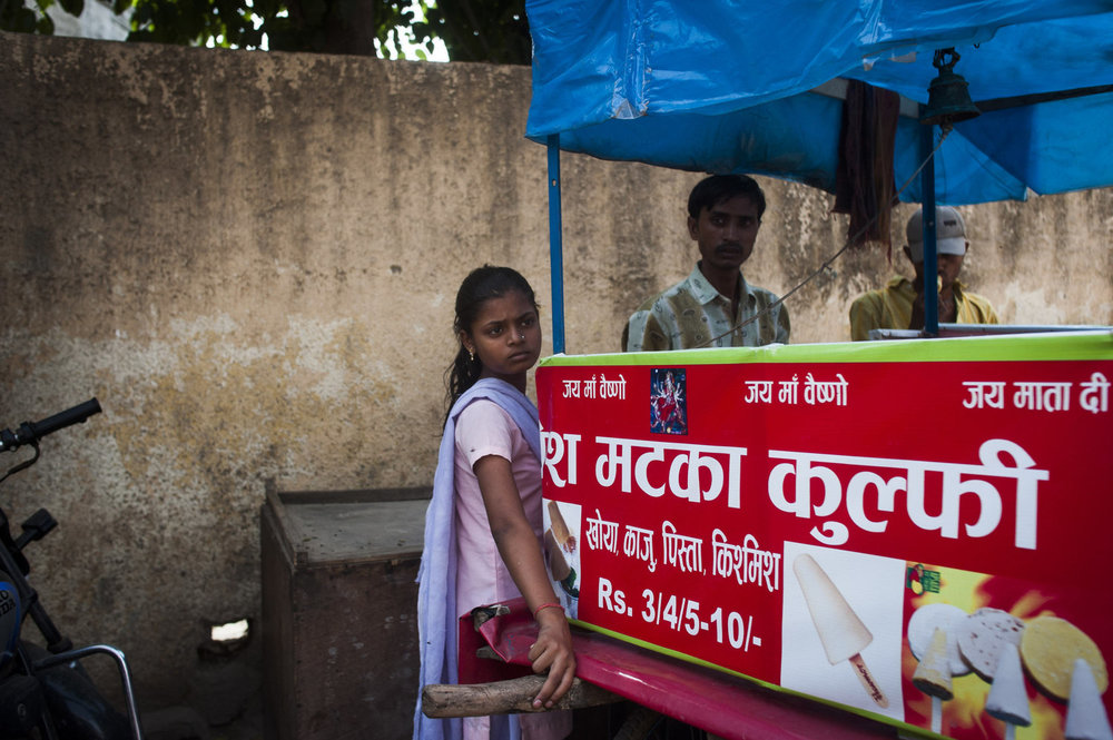 A girl buying an ice cream in the village of Mullahera. 