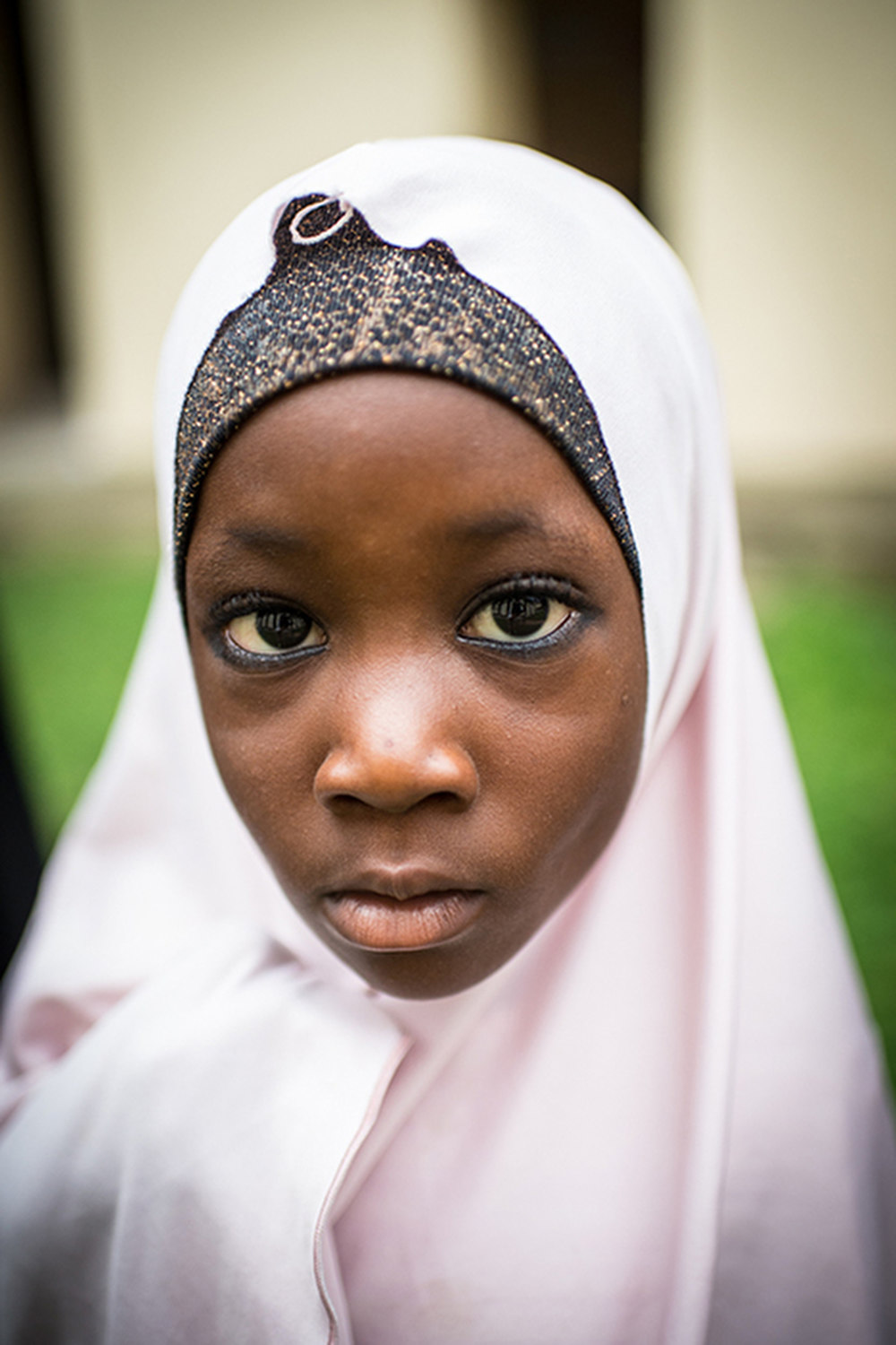 Aisha Hassan who visits the clinic with her mother so she can receive shots for child spacing in Lokoja, Nigeria.