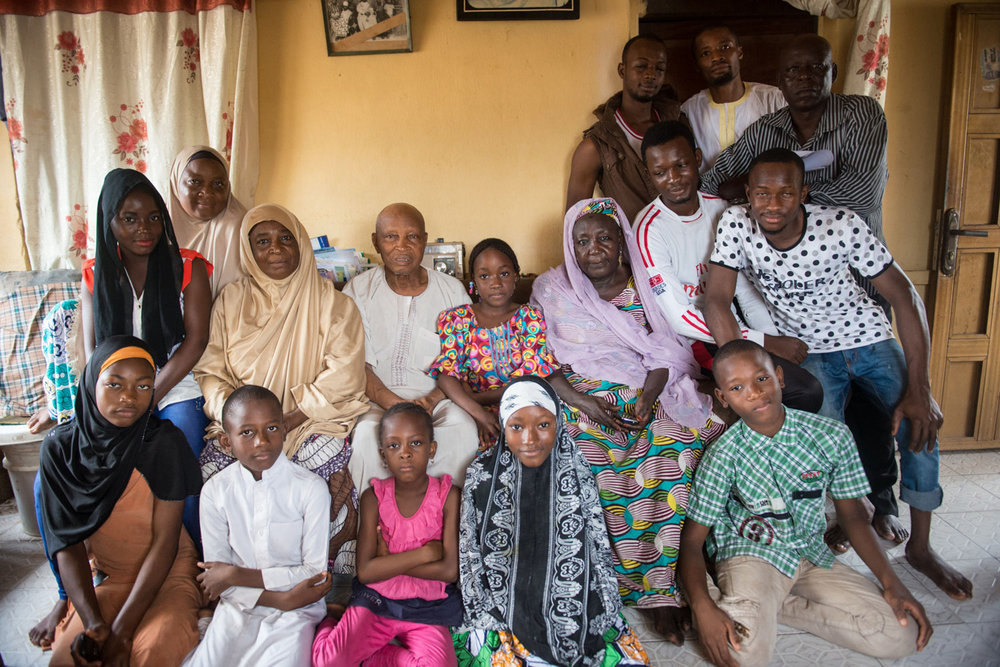 Ahmed Musa, a 93-year-old nut trader, second row, center, sits for a portrait with a small portion of his extensive family.