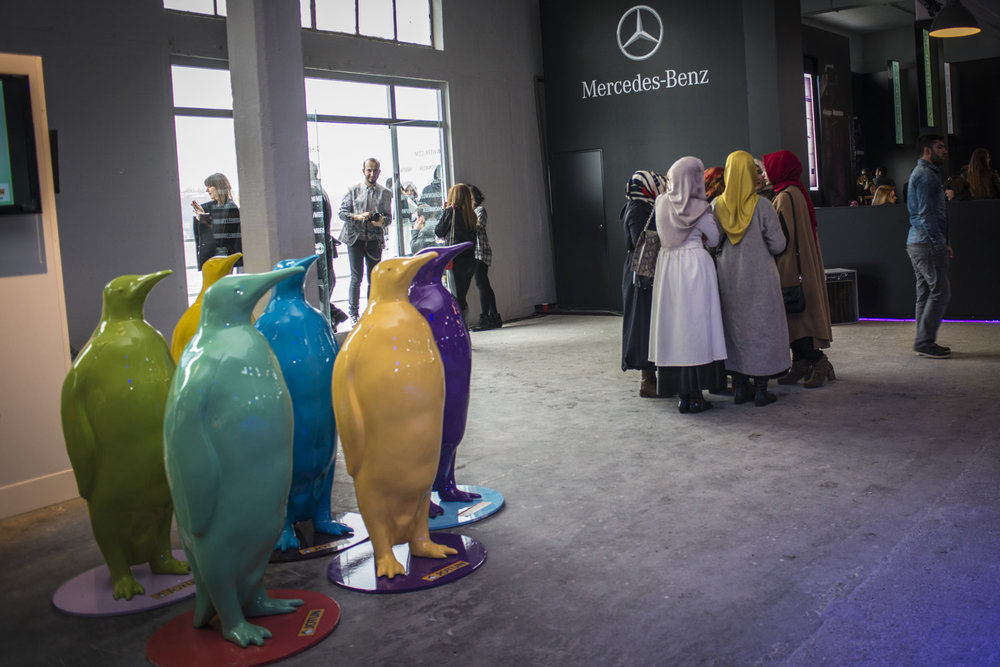 At Mercedes Benz Fashion week a group of women wait to enter the shows in 2014.