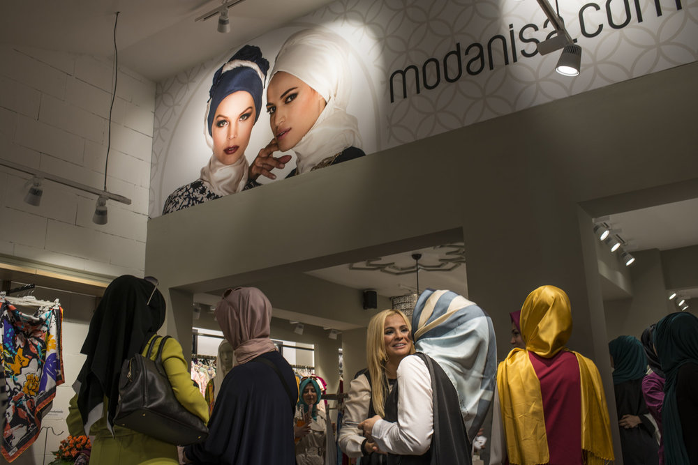 Fans gather at the Modanisa store to see Dubai based designer Rabia Z at the Umraniye store in Istanbul, Turkey.