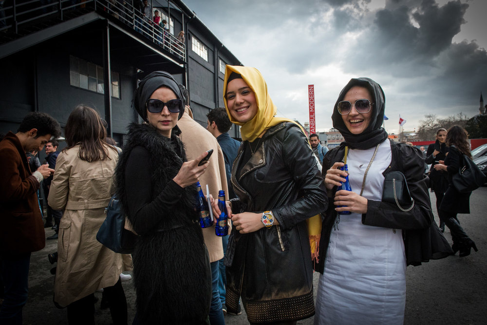 Attendees exit Istanbul Fashion Week in Istanbul Turkey