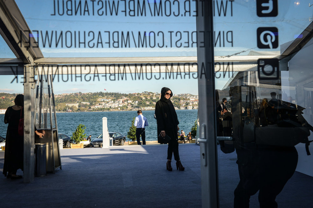 A woman poses at Mercedes Benz Fashion Week Fall/Winter in Kurucesme, Istanbul.