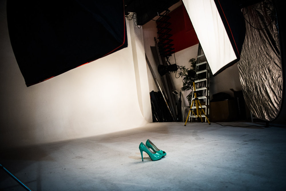 After a shoot, shoes are left by a tired model. The shoot is for accessories and jackets for the fall season.