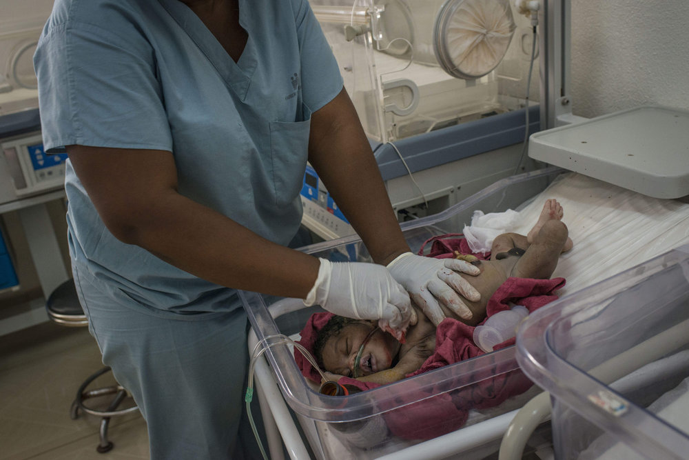 NICU nurses tend to the baby of Kema James, who was born with sepsis.