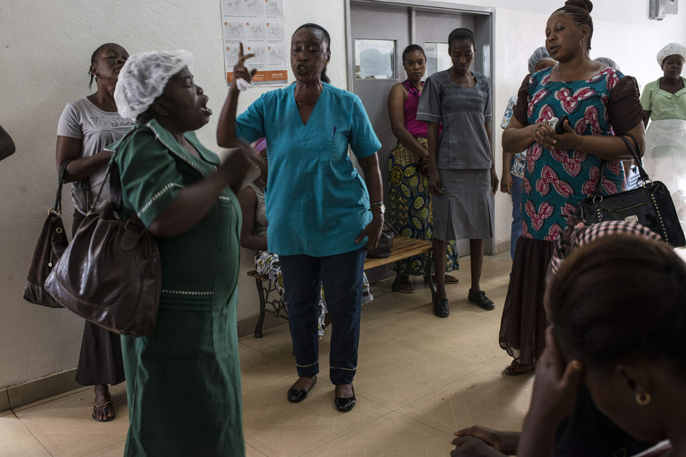 A prayer service starts off the morning in Kenema Goverment Hospital in Kenema, Sierra Leone on November 10th, 2015.