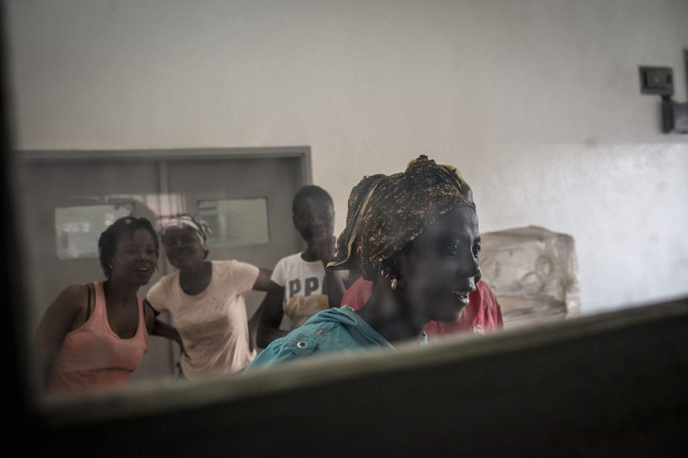 Family members peer into the delivery room at Kenema Government hospital to see how the mothers are faring in Kenema, Sierra Leone on November 10th, 2015.