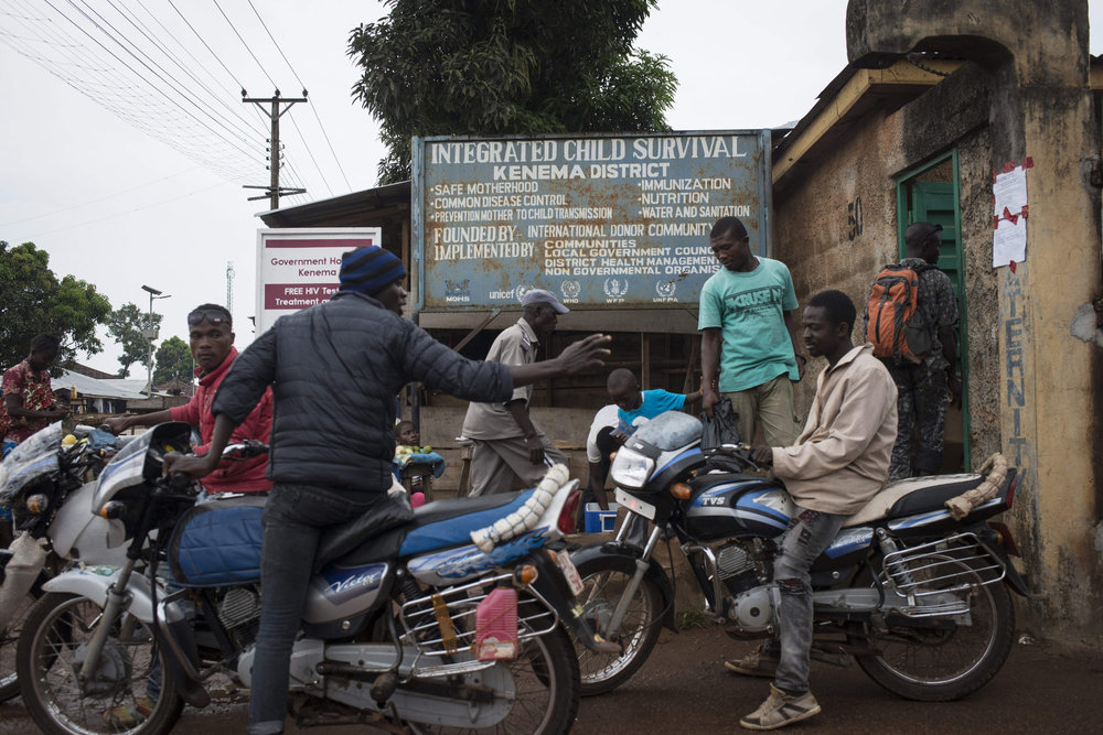 The exterior of Kenema hospital where motorbikes take patients home in Kenema, Sierra Leone on November 10th, 2015.