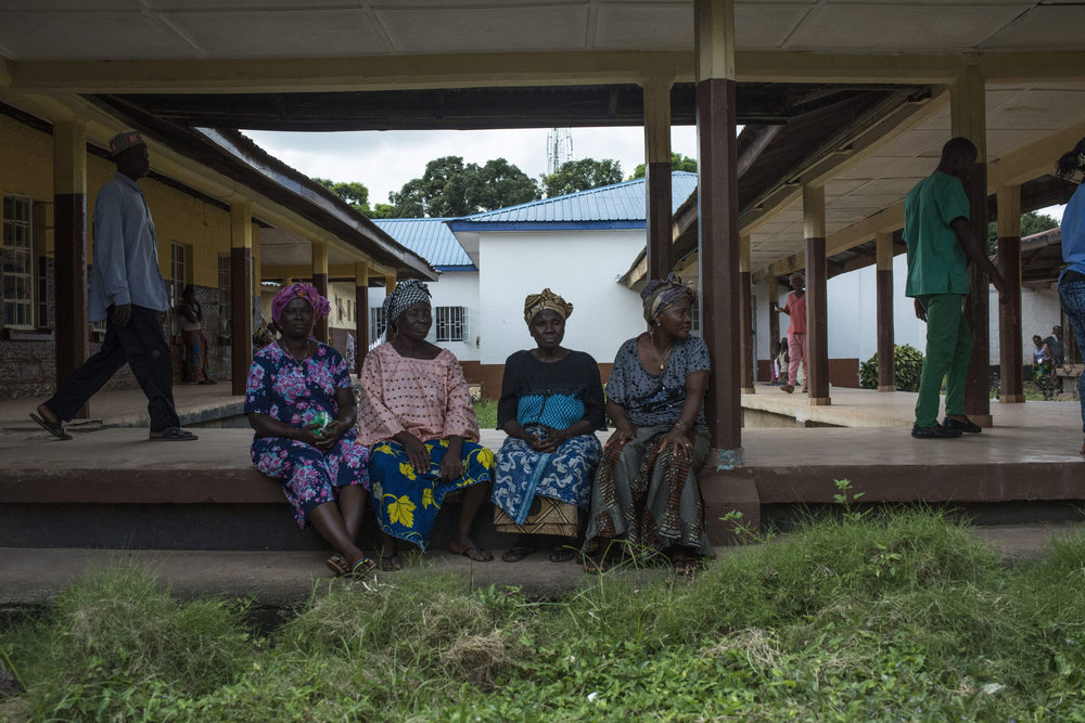 The family of Christiana Dasama,17  waits for her to leave surgery after giving birth at Kenema Government Hospital in Kenema, Sierra Leone on November 11th, 2015.