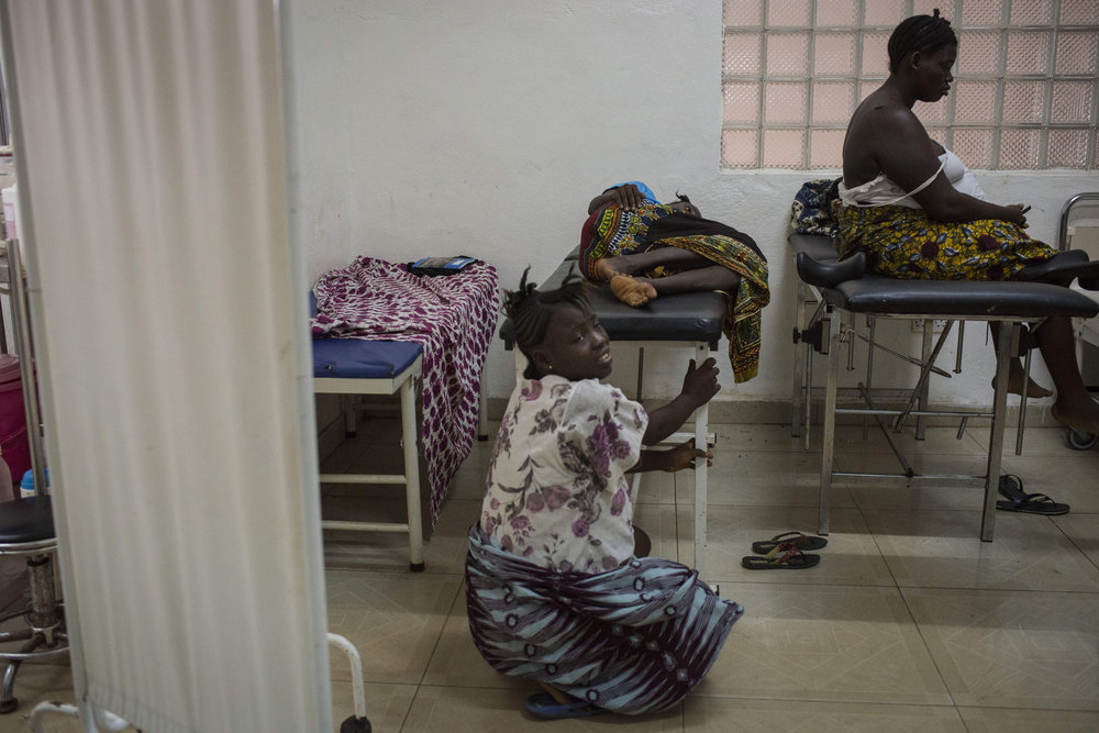 Christiana Dasama,17  is in pain as she waits to give birth at Kenema Government Hospital in Kenema, Sierra Leone on November 11th, 2015.