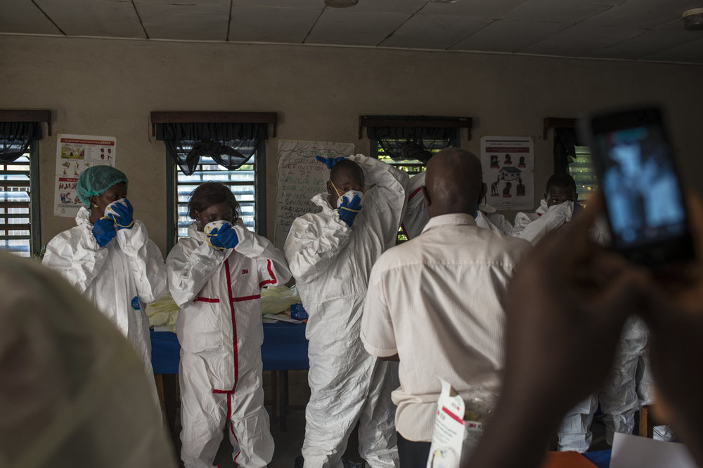 At the training students learn the proper way to put on, and take off protective gear without endangering them or the patients,  this session is administered by Dr. Thierno Sadou.