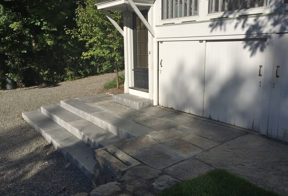 New and old granite from the original steps are combined to create a clean-looking and welcoming entrance area.
