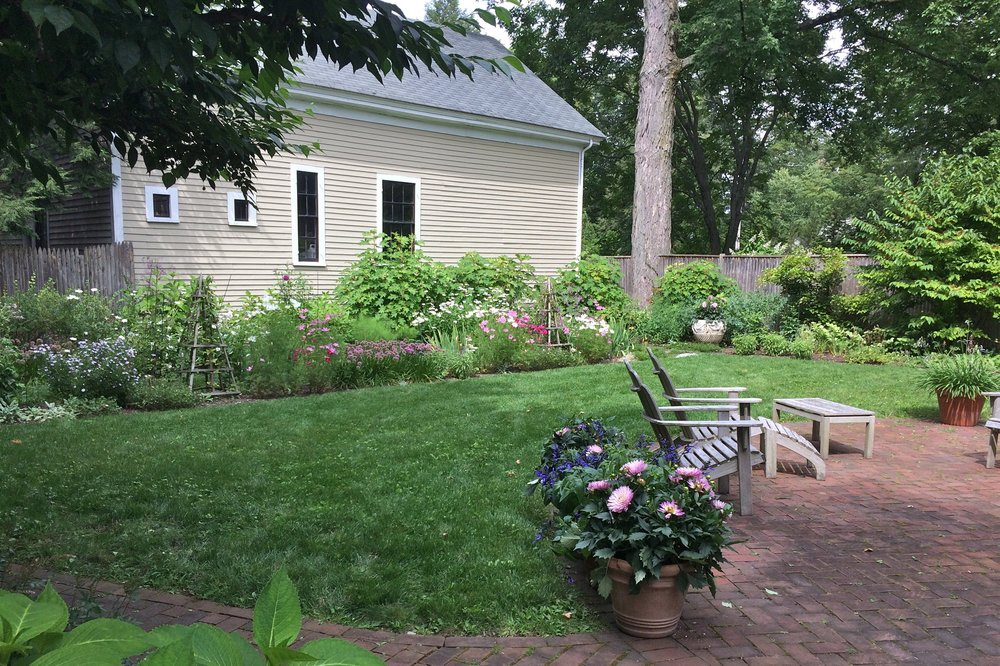 Addition of a long flower border adds color to the garden and reduces the amount of lawn.